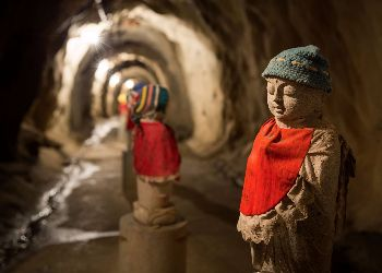 Kid like statues in a cave